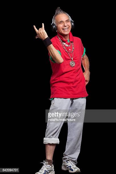 Cheerful man gesturing against black background