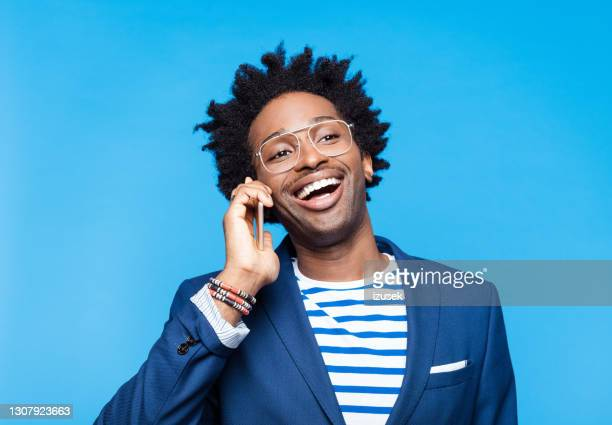 cheerful man talking on smart phone - using phone stock pictures, royalty-free photos & images
