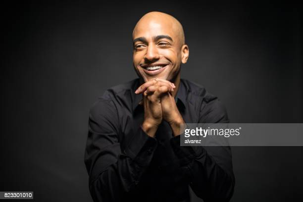 cheerful man with hands clasped looking away - formal portrait stock pictures, royalty-free photos & images