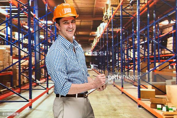 Cheerful manager working in warehouse