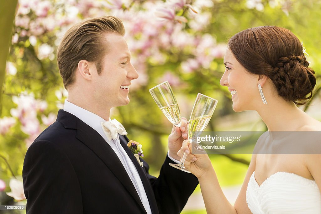 Cheerful married couple toasting with champagne : Stock Photo