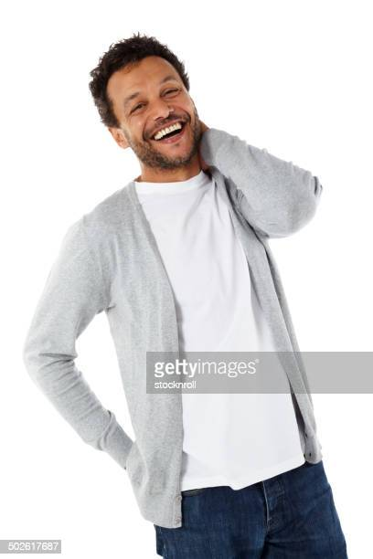 Cheerful mature african man standing on white