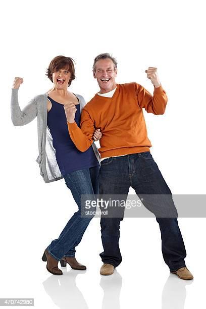 Cheerful mature couple celebrating success