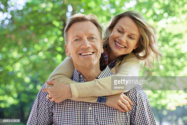 Cheerful mature couple having fun together