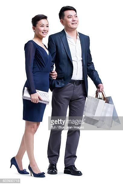 Cheerful mature couple shopping
