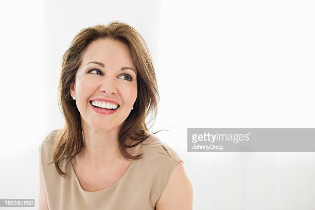 cheerful mature woman looking away - beautiful woman stockfoto's en -beelden