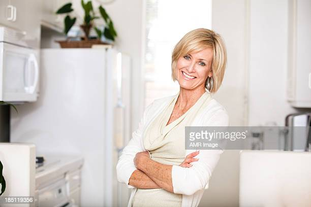 Cheerful mature woman with arms crossed