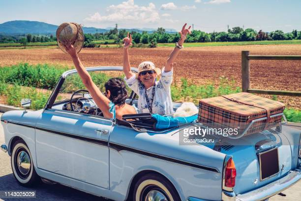 cheerful mature women enjoying on a road trip - vintage lesbian photos stock pictures, royalty-free photos & images