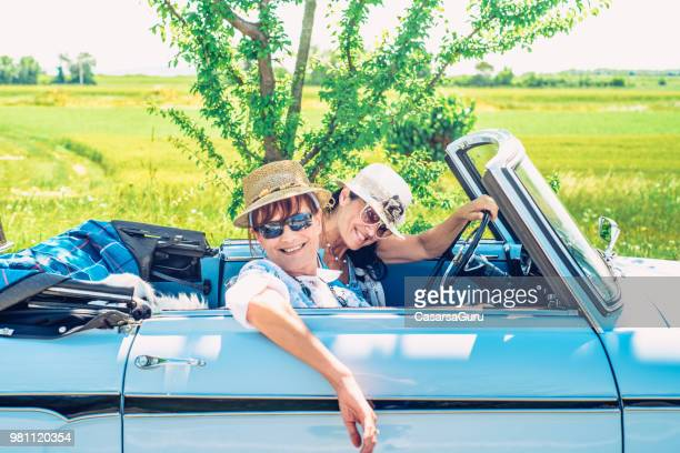 cheerful mature women on road trip - vintage lesbian photos stock pictures, royalty-free photos & images