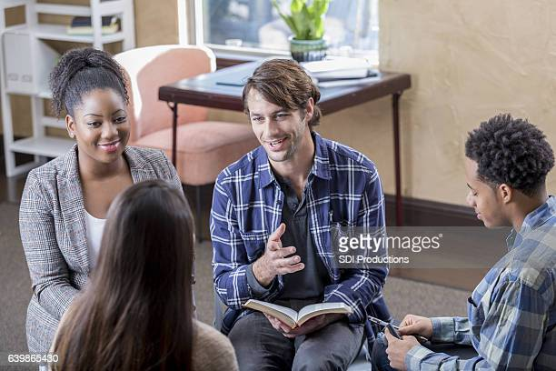 Cheerful mid adult man leads Bible study