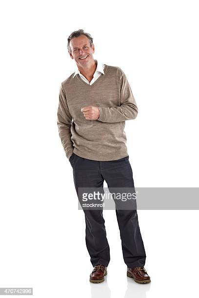 Cheerful middle aged man standing over white