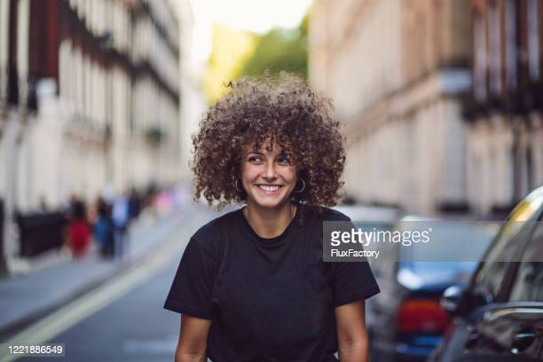 cheerful modern young woman enjoying her stay in london - candid stock pictures, royalty-free photos & images