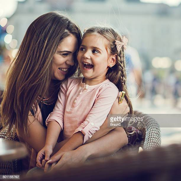 Cheerful mother and daughter enjoying a day together.