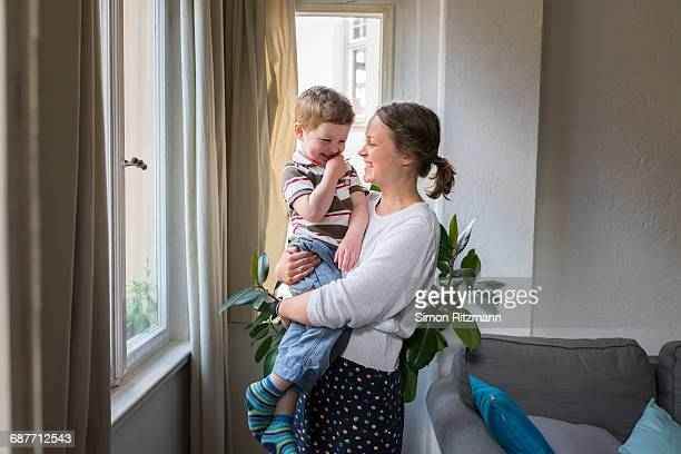 Cheerful mother and toddler son at home