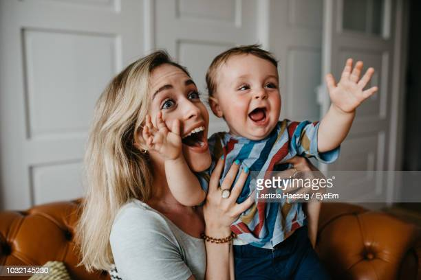 cheerful mother with son at home - surprise stock pictures, royalty-free photos & images