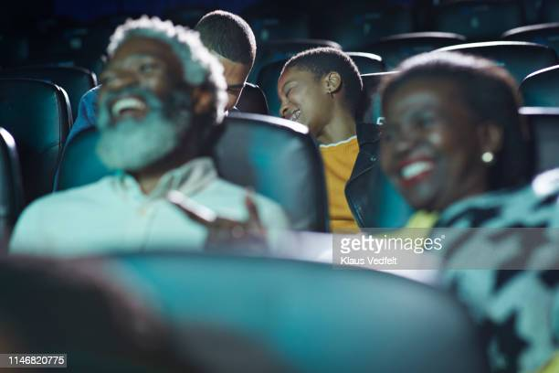 cheerful multi-ethnic audience watching movie in cinema hall at theater - comedy film stock pictures, royalty-free photos & images