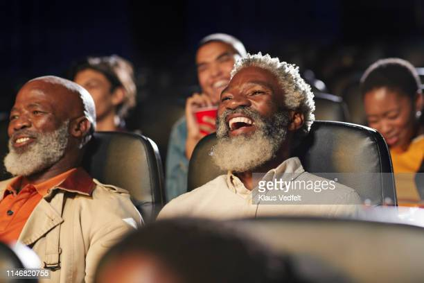 cheerful multi-ethnic spectators watching movie in cinema hall at theater - comedy film stock photos and pictures