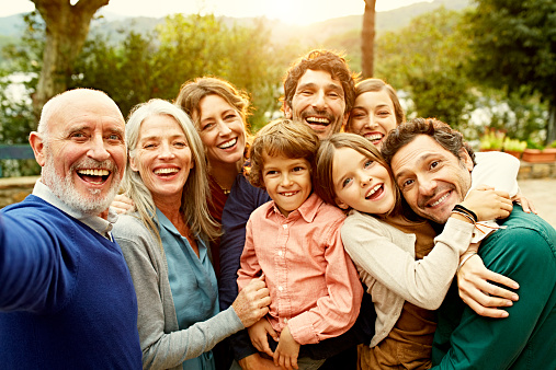 Cheerful multi-generation family at yard - gettyimageskorea