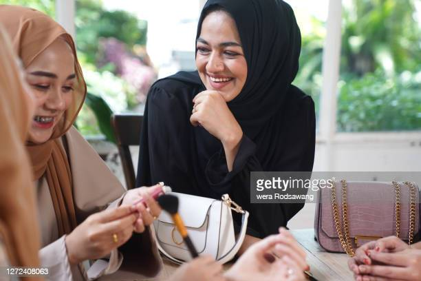 cheerful of young muslim women laughing with friend - ヒジャブ ストックフォトと画像