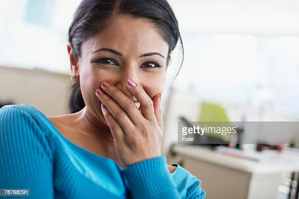 cheerful office worker in office - verlegen stockfoto's en -beelden