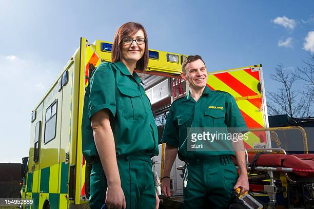 cheerful paramedics - rescue services occupation stock photos and pictures