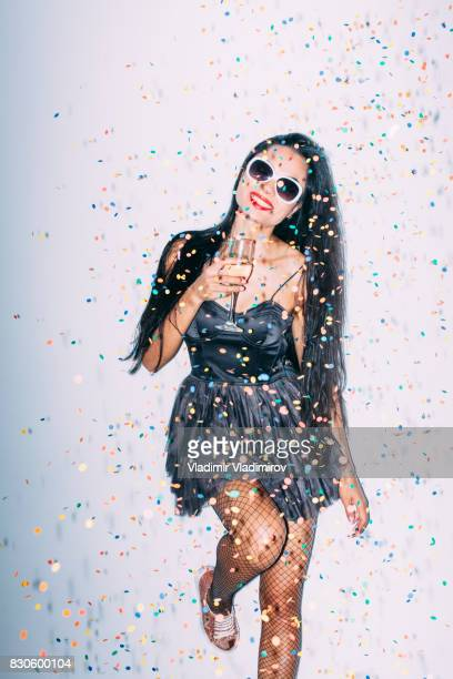 cheerful party girl holding champagne flute - long nylon legs stock pictures, royalty-free photos & images