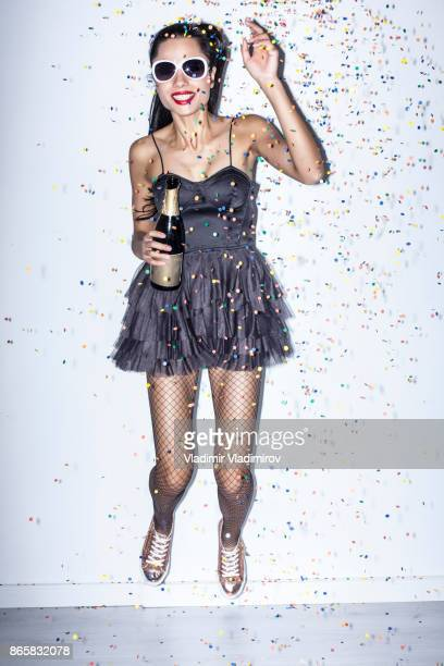 cheerful party girl holding champagne flute - pantyhose model stock photos and pictures