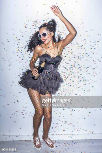 cheerful party girl holding champagne flute - black women wearing pantyhose stock pictures, royalty-free photos & images