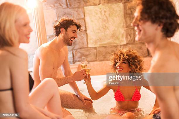 Cheerful people in hot tub.