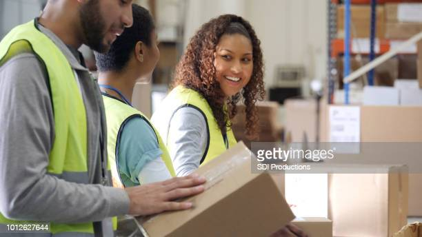 cheerful people working in distribution warehouse - post structure stock photos and pictures
