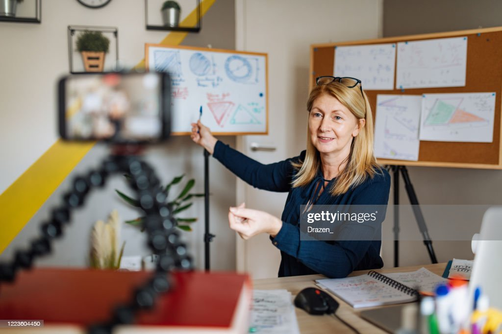 Cheerful professor communicate with pupils over video call : Stock Photo