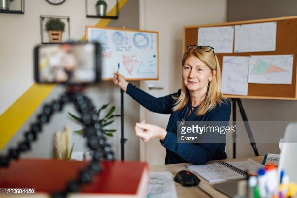 cheerful professor communicate with pupils over video call - demonstration stock pictures, royalty-free photos & images