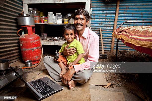Cheerful Rajasthani Rural Indian Father Son Using Laptop Computer