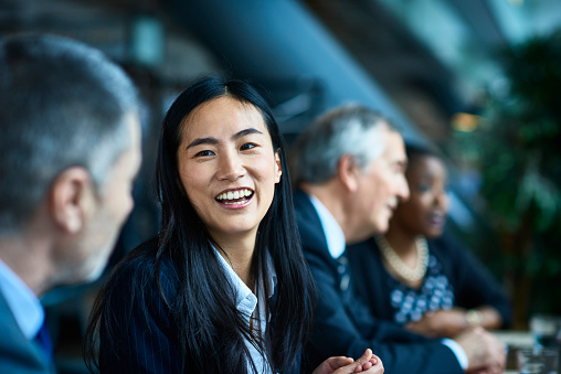 Cheerful relaxed businesswoman with manager in meeting - gettyimageskorea