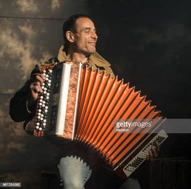 cheerful retro artist playing accordion - accordion stock pictures, royalty-free photos & images