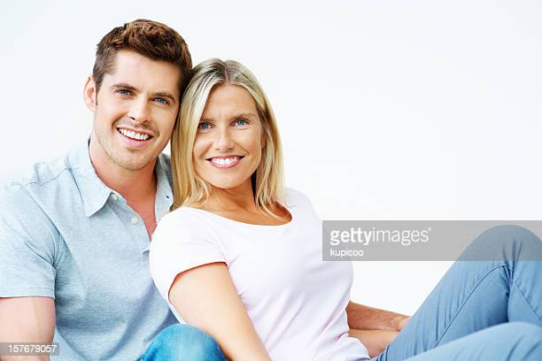 Cheerful romantic middle aged couple sitting together