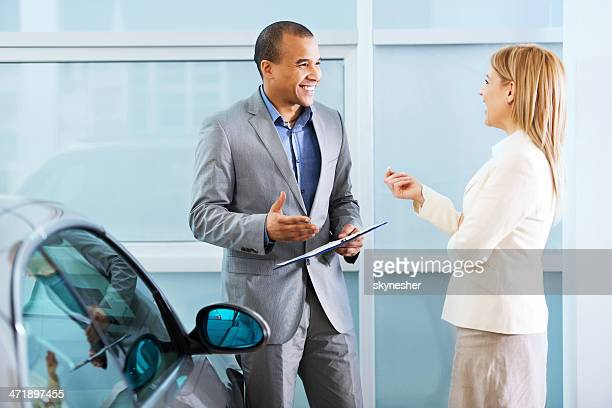 Cheerful salesperson talking to his customer.