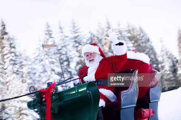 cheerful santa claus waving from sleigh in snow, copy space - sleigh stock photos and pictures