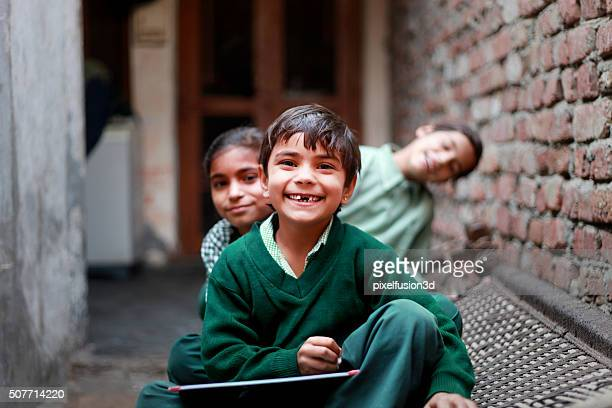 cheerful school students portrait at home - armoede stockfoto's en -beelden