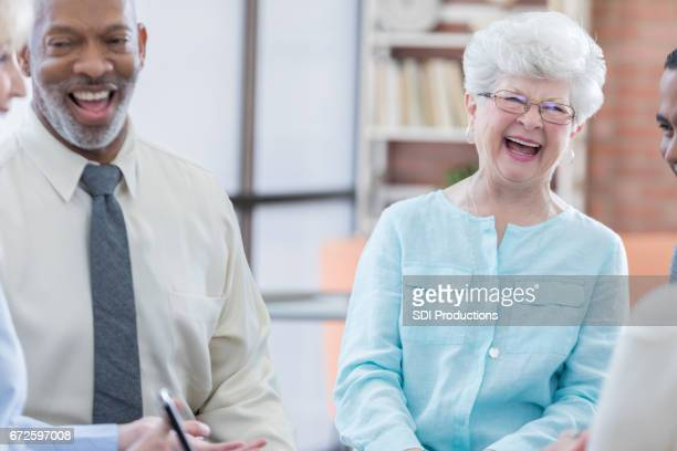 Cheerful senior adults in group therapy session