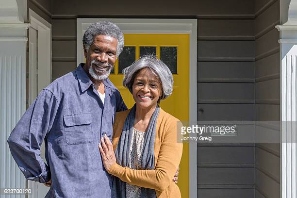 cheerful senior african american couple outside house, smiling - 60 69 years stock pictures, royalty-free photos & images