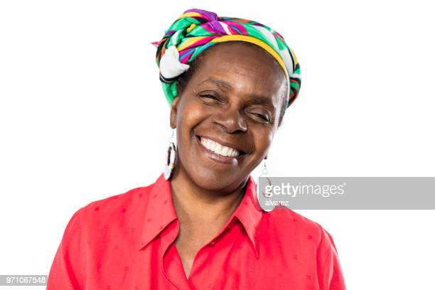 cheerful senior african woman in traditional headdress - argentina traditional clothing stock photos and pictures