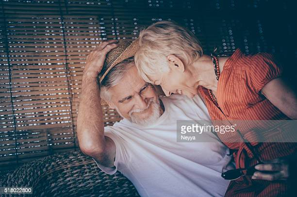 Cheerful Senior Couple Enjoying Summer Day on a Terrace