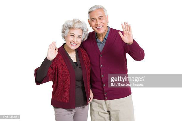 Cheerful senior couple greeting for Chinese New Year