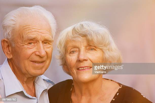cheerful senior couple in the park - vladgans or gansovsky stock pictures, royalty-free photos & images