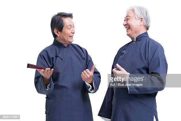Cheerful senior men in traditional clothing