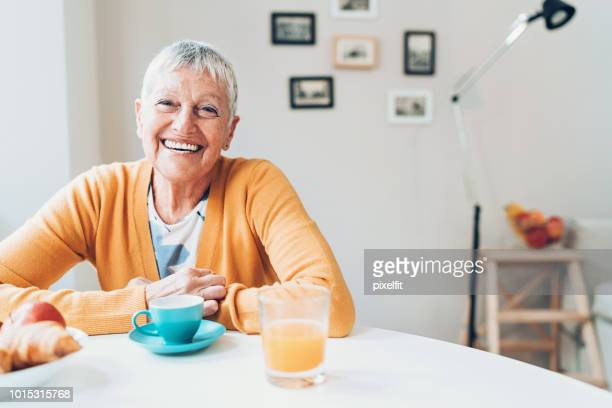cheerful senior woman at home - white hair stock pictures, royalty-free photos & images