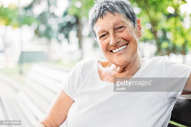 Cheerful senior woman at sunlight