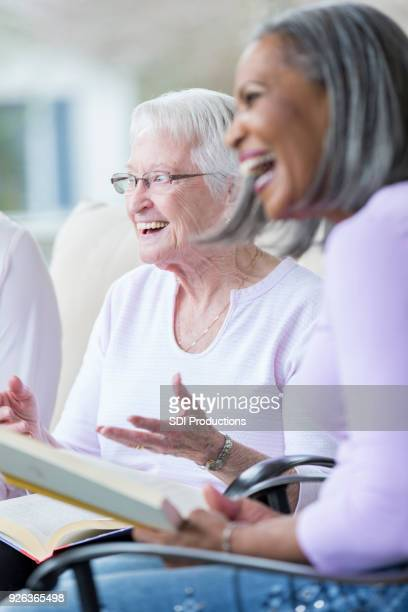 cheerful senior woman during book club - bible photos stock pictures, royalty-free photos & images