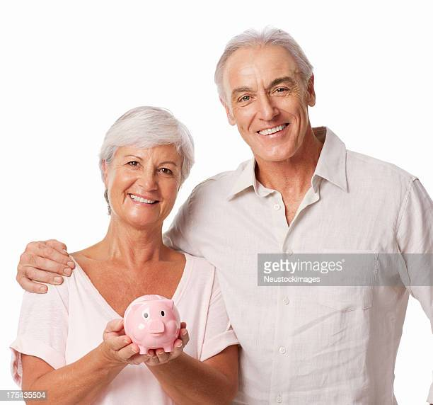 Cheerful Senior Woman Holding Piggy Bank - Isolated